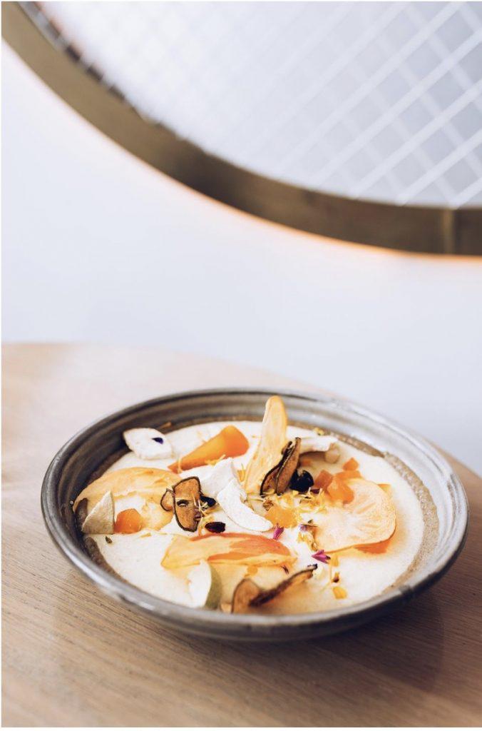 Polenta porridge with peach maple dish