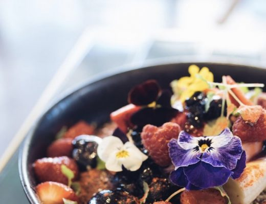 Ricotta Hotcake topped with chocolate sauce, fresh berries, mascarpone, banana and edible flowers