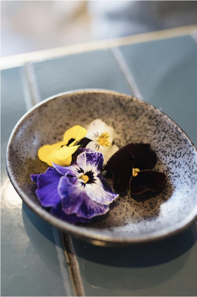 Edible flowers in a stonewear bowl