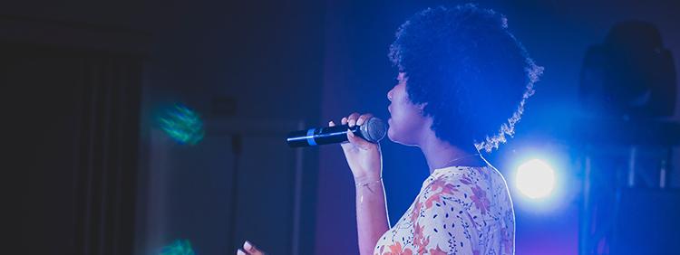 Woman singing with Karaoke Microphone